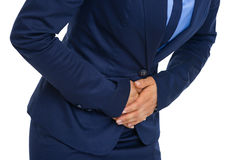 Closeup on business woman having stomach pain Royalty Free Stock Photography