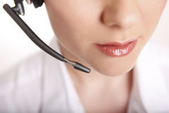 Closeup of a business woman with headset Stock Photo