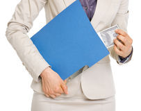 Closeup on business woman hiding pack of dollars. In folder Royalty Free Stock Photos