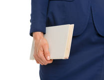 Closeup on business woman holding book Stock Photo