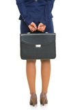 Closeup on business woman holding briefcase Stock Images