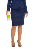 Closeup on business woman holding cup of hot beverage Stock Photo