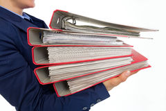 Closeup on business woman holding folders Stock Images