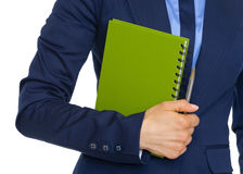 Closeup on business woman holding notepad Stock Images