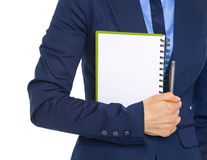 Closeup on business woman holding open notepad Stock Photos