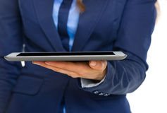 Closeup on business woman holding tablet pc Stock Photo