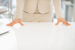 Closeup on business woman leaning on desk Stock Images