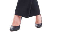 Closeup with business woman legs crossed isolated on white Royalty Free Stock Image