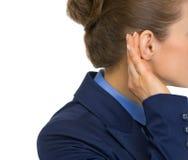 Closeup on business woman listening Stock Photo