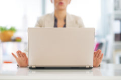 Closeup on business woman meditating near laptop. In office Royalty Free Stock Images