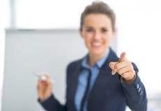 Closeup on business woman near flipchart Stock Photography
