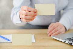 Closeup. Business woman offers business card to the client. Royalty Free Stock Image