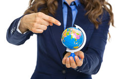 Closeup on business woman pointing on earth globe Stock Images