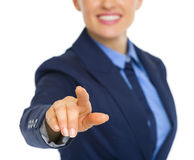 Closeup on business woman pushing button in air Royalty Free Stock Images