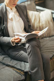 Closeup on business woman reading magazine Stock Images