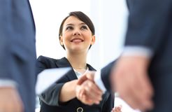 Closeup of business woman shaking hands with her business partner. The concept of partnership Royalty Free Stock Photo