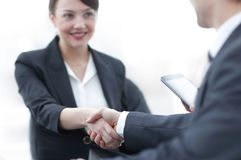 Closeup of business woman shaking hands with her colleague. Royalty Free Stock Photography