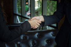 Closeup of a business woman shaking hands Stock Photos