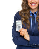 Closeup on business woman showing calculator Stock Photography