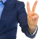 Closeup on business woman showing 2 fingers Stock Image