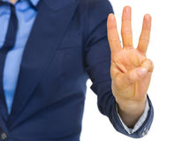 Closeup on business woman showing 3 fingers Stock Images