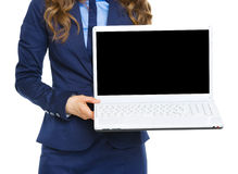Closeup on business woman showing laptop blank screen. Isolated on white stock photography