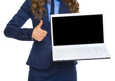 Closeup on business woman showing laptop blank screen Stock Photos
