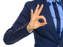 Closeup on business woman showing ok gesture Royalty Free Stock Photography