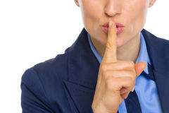 Closeup on business woman showing shh gesture Stock Photography