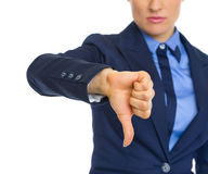 Closeup on business woman showing thumbs down Royalty Free Stock Photo