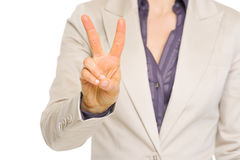 Closeup on business woman showing two with fingers Stock Photography