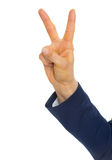 Closeup on business woman showing victory gesture Royalty Free Stock Images