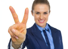 Closeup on business woman showing victory gesture Stock Photography