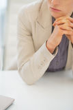 Closeup on business woman sitting at desk Royalty Free Stock Images