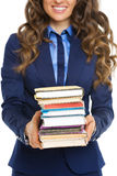 Closeup on business woman with stack of books. Isolated on white Royalty Free Stock Photo