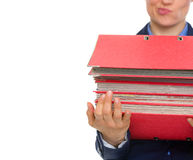 Closeup on business woman with stack of folders Stock Photography