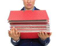 Closeup on business woman with stack of folders Royalty Free Stock Photos