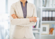 Closeup on business woman standing in office Stock Image