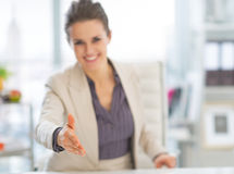 Closeup on business woman stretching hand Stock Image
