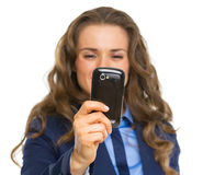 Closeup on business woman taking photo with cell phone Stock Photos
