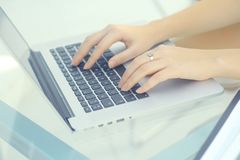 Closeup.business woman typing on a laptop. People and technology Royalty Free Stock Photos