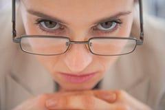 Closeup on business woman wearing eyeglasses Stock Photography