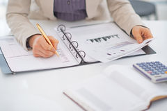 Closeup on business woman working with documents Stock Image