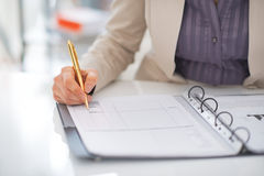 Closeup on business woman working with documents Stock Photography