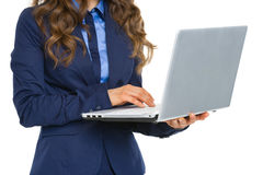 Closeup on business woman working on laptop Royalty Free Stock Photography