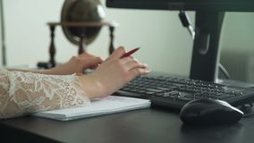 Closeup of business woman working in an office stock video footage