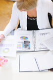 Closeup on business woman working at office table Stock Photography
