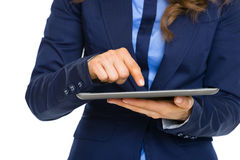Closeup on business woman working on tablet pc Stock Photography