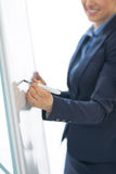 Closeup on business woman writing on flipchart Stock Image
