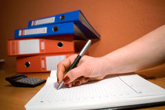 Closeup of a business woman writing in a notebook Royalty Free Stock Image